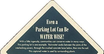 Roadsign stating even a parking lot can be water wise!
